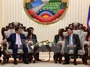 Firman Vietnam y Laos acuerdo de cooperación partidista
