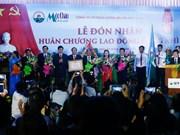 Combatientes voluntarios vietnamitas condecorados por el Estado de Laos