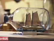 [Fotos] Construcción de barcos dentro de bombillas y botellas