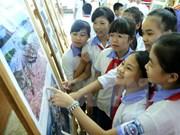 Exposición de fotos resalta figuras destacadas de campaña sobre ejemplo moral de Ho Chi Minh
