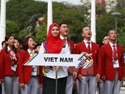 Izada bandera nacional de Vietnam en SEA Games 29 en Malasia