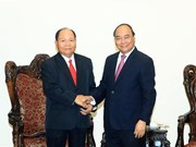 Premier de Vietnam encomia cooperación con Laos en asuntos internos
