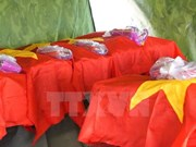 Rinden homenaje póstumo a combatientes voluntarios vietnamitas caídos en Laos
