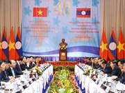 Premieres de Vietnam y Laos copresiden reunión 40 del Comité Intergubernamental