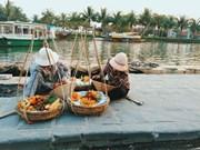 Palos de carga, marca turística de casco antiguo de Hoi An