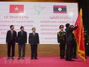 Internacionalistas vietnamitas reciben Orden de Trabajo de Laos