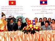 Firman Vietnam y Laos acuerdos de colaboración