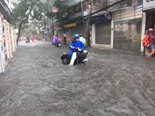 [Fotos] Fuertes lluvias inundan Hanoi